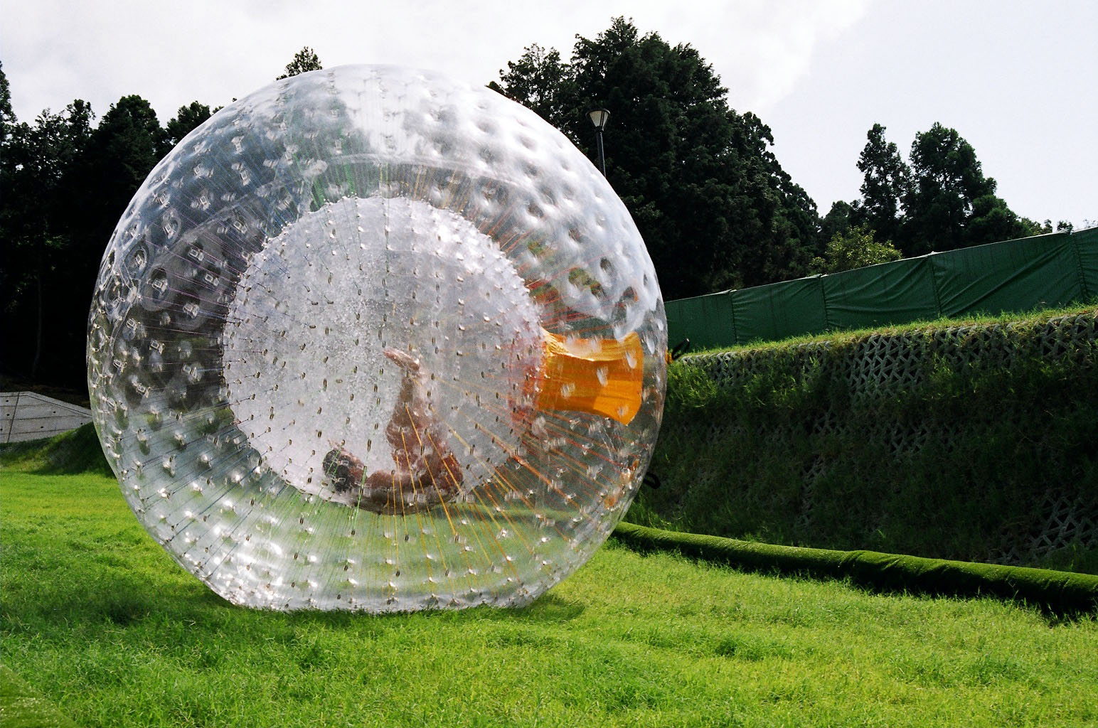 Zorbing globe riding orbing