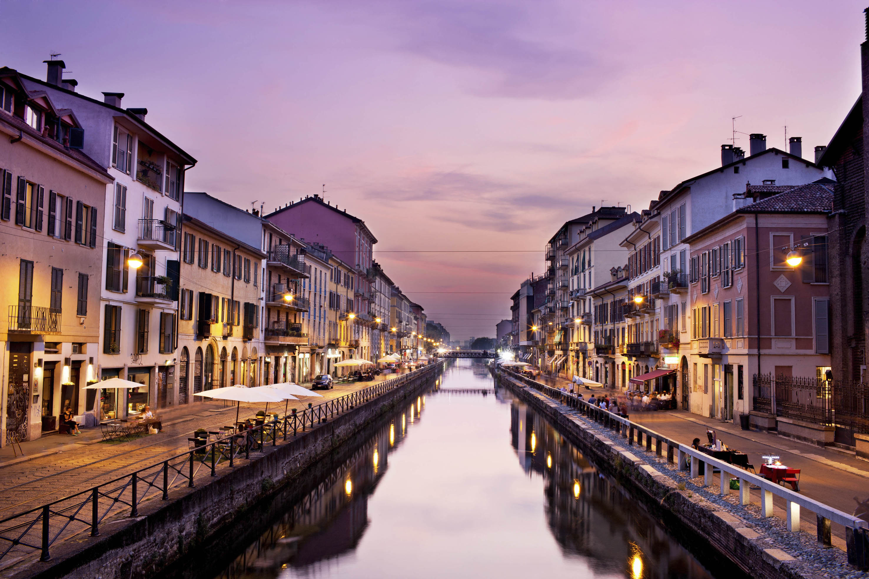 ITALY MILAN Milan, Naviglio Grande at dusk The Naviglio Grande is a canal in Lombardy, northern Italy, joining the Ticino river near Tornavento to the Porta Ticinese dock, also known as the Darsena, in Milan