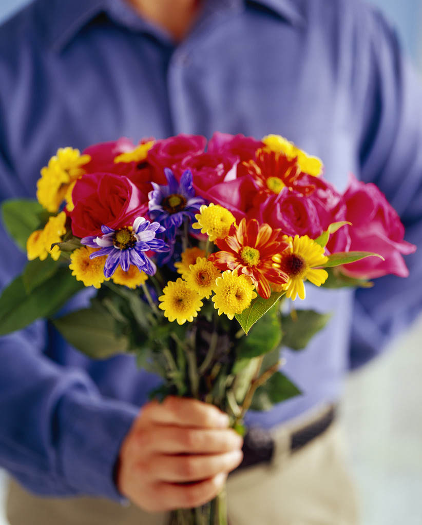 Man with Bouquet --- Image by © Royalty-Free/Corbis