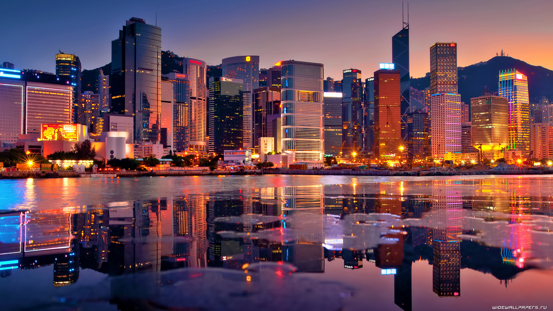 hong-kong-reflected-in-the-bay-at-sunset